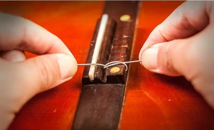 گره زدن سیم گیتار کلاسیک